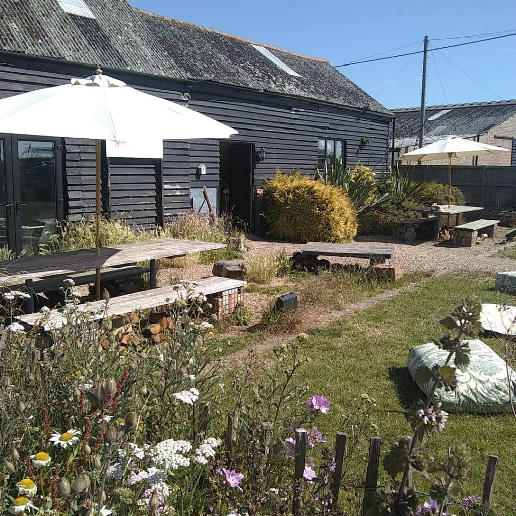 Duck duck goose front garden with scaffold tables, benches and wild flower garden